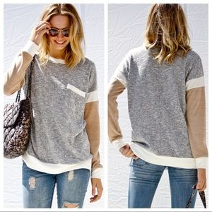 Knit long sleeve top with pocket.
